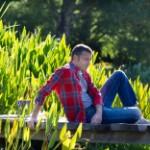 stock-photo-76082537-single-40s-man-sitting-having-a-break-in-a-park