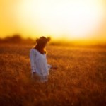 stock-photo-76459773-woman-in-a-wheat-field-at-sunset